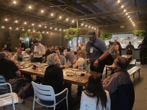 Members of the medical marijuana industry of Missouri share a meal and community at Percheron Rooftop Bar, hosted by Flora Farms