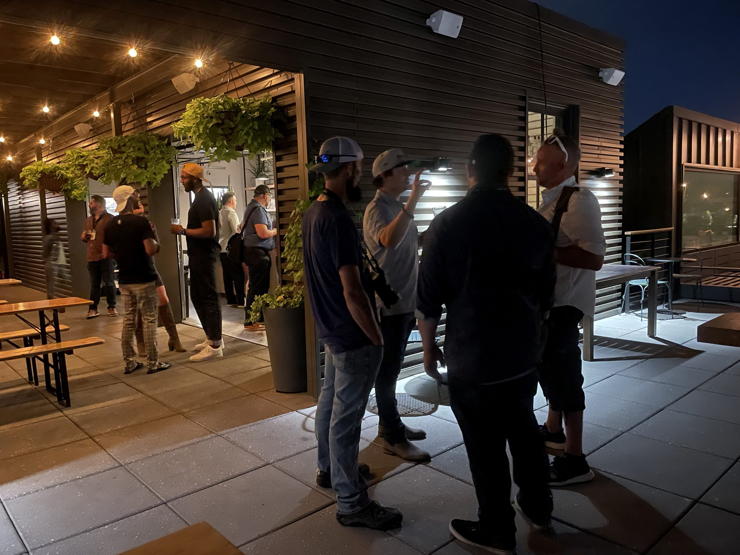 Industry members relax and converse at Flora Farms hosted after-meetup