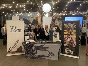 Flora Farms marketing team poses with Cannabis Care Team members April Hatch and Melissa Rush