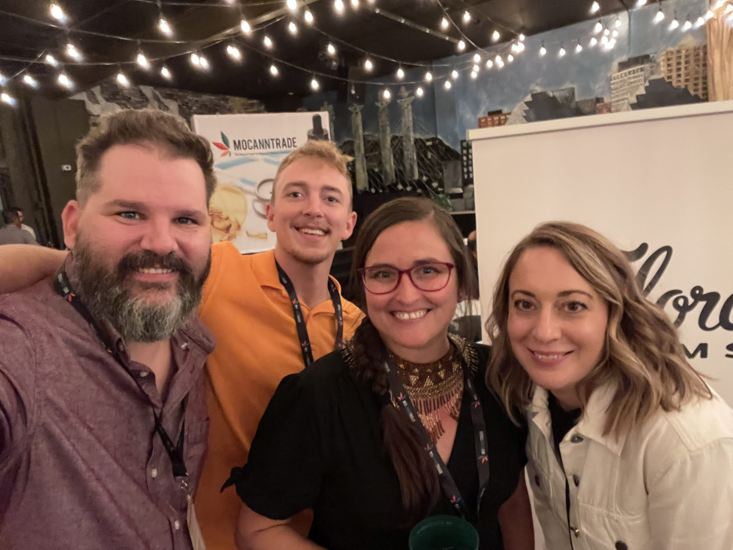 Matthan Black (Operations Director of Flora Farms), Boston Stallings (Blue Sage Cannabis), Karla Deel (Marketing Director - Flora Farms), Mary Kate Black (Staffing & Retail Consultant - Flora Farms) post together at the Flora Farms table
