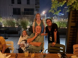 Mary Kate Black, Charlie (West Highland Terrier), Emily Cross, Karla Deel, and Mark Hendren pose together at impromptu after meetup at Percheron Rooftop Bar hosted by Flora Farms